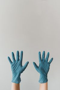 Hands with cleaning gloves on