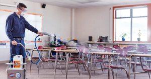 Guy Spraying Classroom