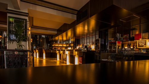 Clean restaurant bar with bottles and