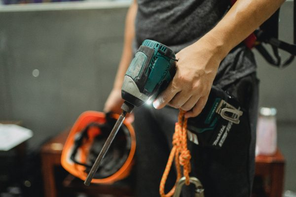 Handyman Holding Drill for Maintenance Services